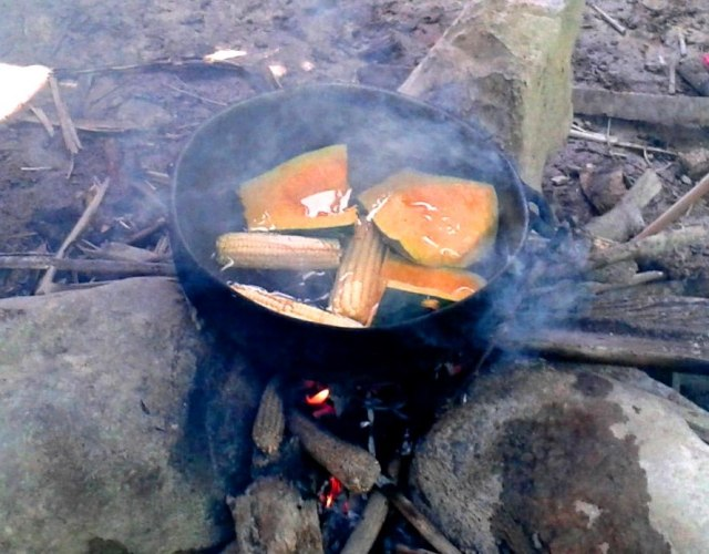 A rustic stove (ok, cooking on three rocks!)